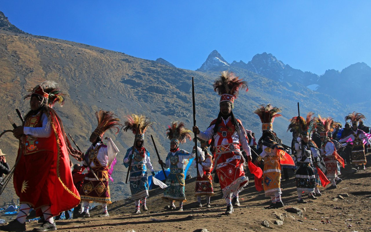 Parade at Quyllurit'i inca festival in the peruvian andes near ausangate mountain.
